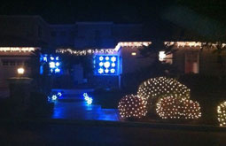 Residential house with christmas lights on house and bushes San Jose Bay Area Themes